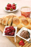 Sweet bread with cherry jam, and chocolate. Continental breakfas Stock Photography