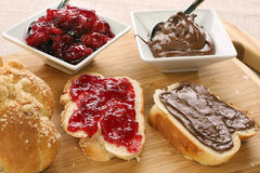 Sweet bread with cherry jam, and chocolate. Stock Photos