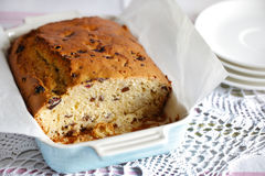 Sweet bread or pound cake with dried fruit, sliced in a baking dish Stock Images