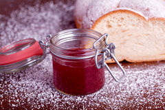 Sweet bread with red strawberry jam Stock Images