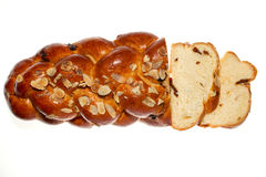 Sweet bread on the white background. Sweet bread with almonds on the white background Royalty Free Stock Photos