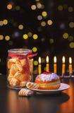 Sweet break with Hanukkah doughnuts. royalty free stock images