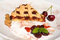 Sweet Breakfast. Food & Drinks - Slice of tart with sour cherry jam Stock Image