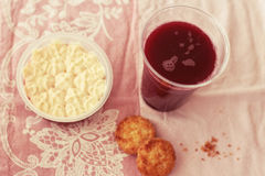 Sweet breakfast. A still-life of a strawberry dessert, cranberry juice  and some cookies Stock Photos