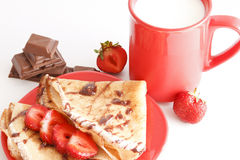 Sweet Breakfast. Sweet meal with cup of milk and cakes and chocolate and strawberries stock images