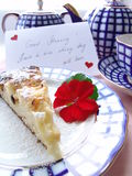 Sweet breakfast. With love served breakfast. Cup of tea with a piece of cake decorated with postcard: Good morning! Have a nice day! With love Stock Photo