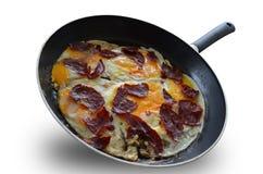 Tavada rafadan pastirmali yumurta Stock Image