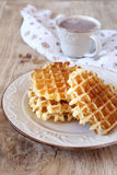 Sweet breakfast: Belgian waffles and cup of cocoa Stock Images