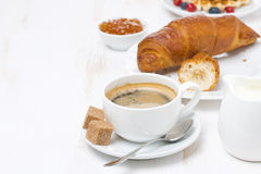 Sweet breakfast with black coffee, croissants and orange jam Royalty Free Stock Photography