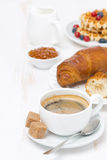 Sweet breakfast with black coffee, croissants, orange jam Royalty Free Stock Images