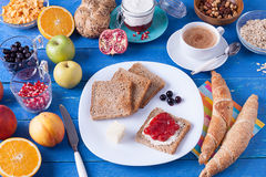 Sweet breakfast on a blue wooden table Royalty Free Stock Photography