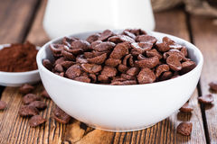 Sweet Breakfast (choco flakes). Portion of sweet breakfast (choco flakes) on wooden background Royalty Free Stock Photography