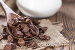 Sweet Breakfast (choco flakes). Portion of sweet breakfast (choco flakes) on wooden background Stock Photography