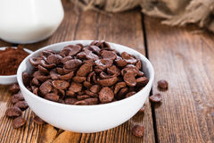 Sweet Breakfast (choco flakes). Portion of sweet breakfast (choco flakes) on wooden background Stock Photos