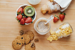 Sweet breakfast with Coffee, milk, corn flakes, cookies, croissa Stock Photo