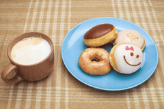 Sweet breakfast with coffee. Sweet breakfast with mug of coffee and several donuts Stock Image