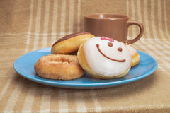 Sweet breakfast with coffee. Sweet breakfast with mug of coffee and several donuts Stock Photos