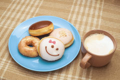Sweet breakfast with coffee. Sweet breakfast with mug of coffee and several donuts Stock Photo