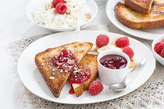 Sweet breakfast - crispy toasts with fresh raspberries, banana Royalty Free Stock Photography