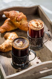 Sweet breakfast with croissant and hot coffee Royalty Free Stock Photography