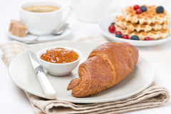Sweet breakfast with croissant, jam, waffles, berries and coffee Stock Photography