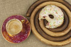Sweet breakfast. Fresh coffee and a donut. Royalty Free Stock Photography