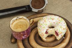 Sweet breakfast. Fresh coffee and a donut. Stock Image