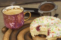 Sweet breakfast. Fresh coffee and a donut. Stock Photo