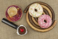 Sweet breakfast. Fresh coffee and a donut. Stock Images