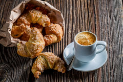 Sweet breakfast with hot coffee and fresh croissant Stock Photo
