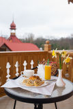 Sweet breakfast and orange juice on the table Royalty Free Stock Photos