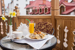 Sweet breakfast and orange juice on the table Royalty Free Stock Photo