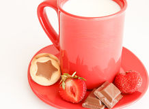 Sweet Breakfast with red cup of milk. Sweet meal with cup of milk and cakes and chocolate and strawberries stock photos
