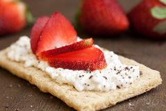 Sweet breakfast. With strawberries on a wooden board Royalty Free Stock Images