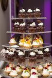 Sweet bridal buffet: cakes - muffins and muffins stacked in a pyramid Royalty Free Stock Images