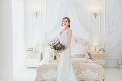 Sweet bride with a wedding bouquet. royalty free stock images
