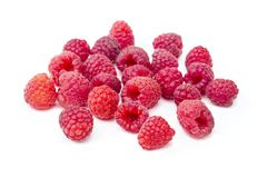 Sweet bright tasty ripe raspberries, group of berries, isolated on white background, close up. Sweet bright tasty ripe raspberries, group of red berries Stock Photos