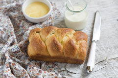 Sweet brioche on a light wooden background Royalty Free Stock Photography
