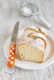 Sweet brioche with sugar on a white plate Royalty Free Stock Images