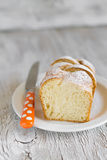 Sweet brioche with sugar on a white plate Royalty Free Stock Photos