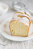 Sweet brioche with sugar on a white plate Stock Image