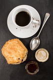 Sweet british raisin scone and a glass filled with honey Stock Photo