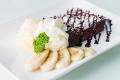 Sweet brownies. Or chocolate fancy cakes Royalty Free Stock Photography