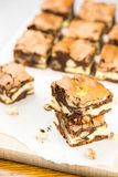 Sweet brownies stacked on white paper Stock Photography