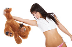 Sweet brunette with a teddy bear. On a white background stock image