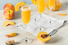 Sweet Bubbly Peach Bellini Mimosa. With Champagne Stock Images