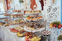Sweet buffet table. Luxury decorated tables in the wedding hall Royalty Free Stock Photos