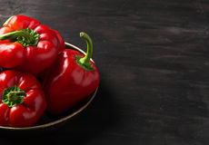 Sweet Bulgarian pepper on dark background. Sweet red Bulgarian pepper on dark background. Space for text Stock Photos