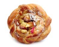 Sweet bun with apple closeup Stock Photography