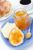 Sweet bun with apricot jam, coffee for breakfast Royalty Free Stock Image